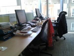 Gaynor's desk (closest) Maureen's desk (by window)